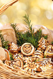 Gingerbread in a wicker basket on golden blurry light background Stock Photography