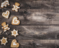 Gingerbread on a wooden background royalty free stock images