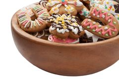 Gingerbread in wooden plate. Isolated. Royalty Free Stock Photos