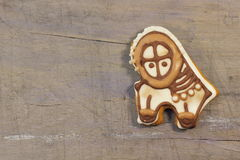 Gingerbread on a wooden texture Stock Images