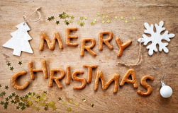 Gingerbread words Merry Christmas. On old wooden table Stock Photos