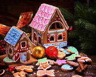 Gingerbread Xmas houses with colorful roof on wooden table. Stock Image