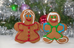 Gingerbreadman and woman holding hands Stock Photography