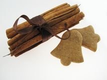 Gingerbreads & cinnamon. Gingerbreads in a bell shape and sicks  of  cinnamon Stock Images