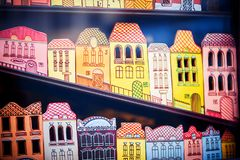 Gingerbreads on counter of store, a city of gingerbread colored houses stock photography