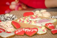 Gingerbreads decorated with designer dresses and roses royalty free stock photography