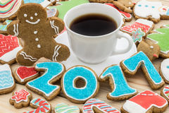 Gingerbreads are decorated for the new 2017 year and cup of coffee (can be used as card) Royalty Free Stock Images