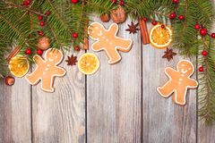Gingerbreads and fir tree Royalty Free Stock Images