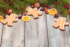 Gingerbreads and fir tree Royalty Free Stock Image