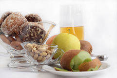 Gingerbreads, fruit and juice. Fruit, nutlets, gingerbreads and juice on a gray background. Horizontally Stock Images