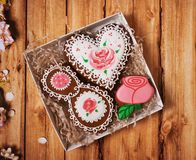 Gingerbreads in gift box on a wooden background stock photo
