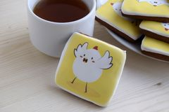 Gingerbreads with the image of chicken are on a table. Gingerbreads are a dessert for Easter. royalty free stock image