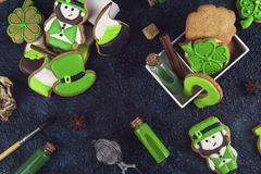 Gingerbreads for Patrick`s day. And on wooden background Royalty Free Stock Photo