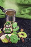 Gingerbreads for Patrick`s day. And on wooden background Royalty Free Stock Photos