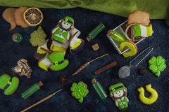 Gingerbreads for Patrick`s day. And on wooden background Stock Photos