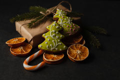 Gingerbreads with a ribbon on a wooden christmas table Royalty Free Stock Images