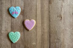 Gingerbreads heart on a wooden background royalty free stock photography
