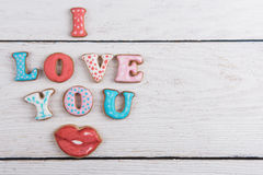 Gingerbreads for Valentines Day. In gift box on white wooden background, I love you sign stock photos
