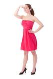 Gingerish woman in pretty dress. Gingerish woman looking to distance, wearing pretty pink dress and high heel shoes Stock Photos