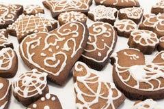 Gingerman kakor i asken Royaltyfria Bilder