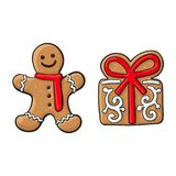 Gingerman, present Christmas gingerbread cookies. Glazed gingerman and present box Christmas gingerbread cookies, sketch vector illustration isolated on white Royalty Free Stock Images
