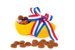 Gingernuts and candy in a clog Royalty Free Stock Photo