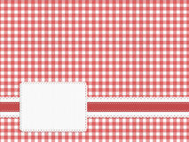 Gingham fabric label background, embossed red, white. Royalty Free Stock Image