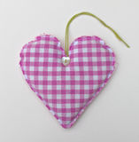 Gingham heart. Simple pink gingham fabric heart Royalty Free Stock Photo