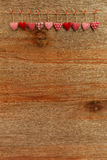 Gingham Love Valentine's hearts hanging on wooden texture backgr Stock Photos
