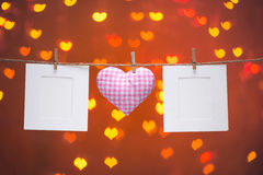 Gingham Love Valentines hearts natural cord and wooden clips hanging on the clothesline heart bokeh sparkle background. Copy space Royalty Free Stock Photos