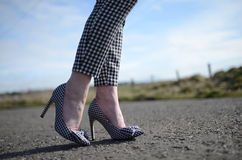 Gingham Stiletto shoe on woman's foot. Gingham high heel shoes at party on lady's feet stock photography