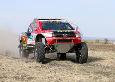 Giniel de Villiers and Dirk von Zitzewitztest driving the Toyota. Sun City, South Africa – OCTOBER 1, 2016: Dakar legends Giniel de Villiers and navigator Royalty Free Stock Images