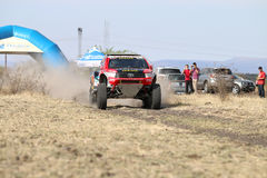 Giniel de Villiers and Dirk von Zitzewitztest driving the Toyota. Sun City, South Africa – OCTOBER 1, 2016: Dakar legends Giniel de Villiers and navigator Royalty Free Stock Image