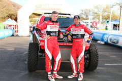 Giniel de Villiers and navigator, Dirk von Zitzewitz in front of. Sun City, South Africa – OCTOBER 1, 2016: Dakar legends Giniel de Villiers and navigator Royalty Free Stock Photos