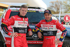 Giniel de Villiers and navigator, Dirk von Zitzewitz in front of. Sun City, South Africa – OCTOBER 1, 2016: Dakar legends Giniel de Villiers and navigator Stock Image