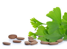 Ginkgo Biloba leaves with pills Stock Images