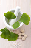 Ginkgo biloba leaves and pills Stock Images