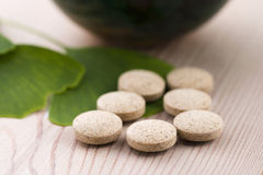 Ginkgo biloba leaves and pills Royalty Free Stock Image
