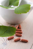 Ginkgo biloba leaves and pills Stock Photo