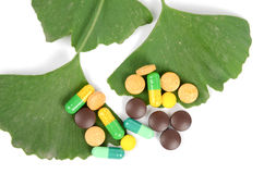 Ginkgo leaf and medicine Stock Photography