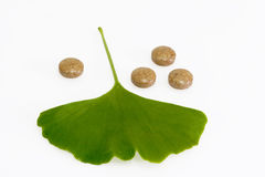 Ginkobiloba. Ginkgo biloba leaf with pills on bright background Royalty Free Stock Image