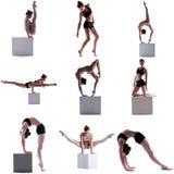 ginnastica Insieme della ragazza flessibile che posa sul cubo Fotografia Stock