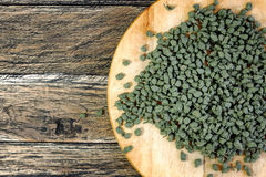 Ginseng Green Oolong Tea on wooden board Stock Photography
