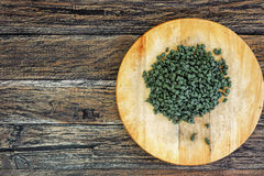 Ginseng Green Oolong Tea on wooden board Stock Images