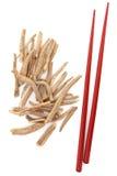 Ginseng. Herb with red chopsticks over white background. Ashwagandha Royalty Free Stock Image
