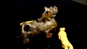 Ginseng, root on a turn table. With antique Chinese lion figure of jade stock video footage