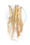 Ginseng roots. Dry ginseng roots on the plate Royalty Free Stock Photography