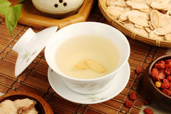 Ginseng tea. Chinese traditional ginseng tea and herbs Royalty Free Stock Images