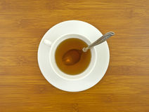 Ginseng tea with spoon on tabletop Stock Image