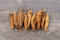 Ginseng on wood table Royalty Free Stock Images
